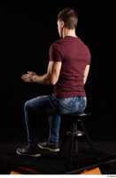 Tomas Salek  1 blue jeans dressed grey shoes red t shirt sitting whole body 0010.jpg