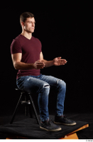 Tomas Salek  1 blue jeans dressed grey shoes red t shirt sitting whole body 0014.jpg