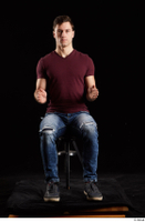 Tomas Salek  1 blue jeans dressed grey shoes red t shirt sitting whole body 0015.jpg