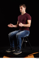 Tomas Salek  1 blue jeans dressed grey shoes red t shirt sitting whole body 0016.jpg