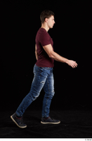 Tomas Salek  1 blue jeans dressed grey shoes red t shirt side view walking whole body 0005.jpg