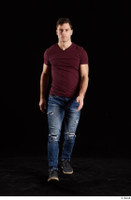 Tomas Salek  1 blue jeans dressed front view grey shoes red t shirt walking whole body 0001.jpg