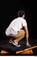 Pablo  1 brown trousers dressed kneeling red sneakers white t shirt whole body 0006.jpg