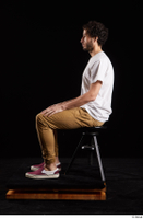 Pablo  1 brown trousers dressed red sneakers sitting white t shirt whole body 0001.jpg