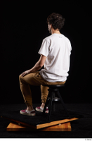 Pablo  1 brown trousers dressed red sneakers sitting white t shirt whole body 0002.jpg