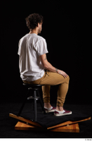 Pablo  1 brown trousers dressed red sneakers sitting white t shirt whole body 0004.jpg