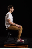 Pablo  1 brown trousers dressed red sneakers sitting white t shirt whole body 0005.jpg