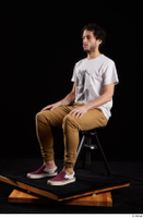 Pablo  1 brown trousers dressed red sneakers sitting white t shirt whole body 0008.jpg