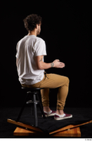 Pablo  1 brown trousers dressed red sneakers sitting white t shirt whole body 0012.jpg