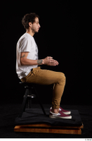 Pablo  1 brown trousers dressed red sneakers sitting white t shirt whole body 0013.jpg