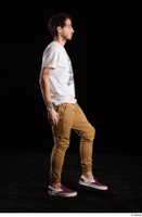 Pablo  1 brown trousers dressed red sneakers walking white t shirt whole body 0003.jpg