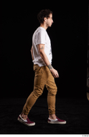 Pablo  1 brown trousers dressed red sneakers walking white t shirt whole body 0005.jpg