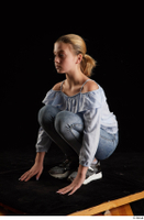 Sarah  1 black sneakers blue blouse blue jeans dressed kneeling whole body 0002.jpg