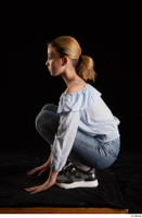 Sarah  1 black sneakers blue blouse blue jeans dressed kneeling whole body 0003.jpg