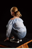Sarah  1 black sneakers blue blouse blue jeans dressed kneeling whole body 0004.jpg