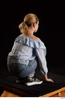 Sarah  1 black sneakers blue blouse blue jeans dressed kneeling whole body 0006.jpg