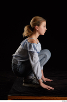 Sarah  1 black sneakers blue blouse blue jeans dressed kneeling whole body 0007.jpg