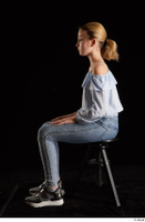 Sarah  1 black sneakers blue blouse blue jeans dressed sitting whole body 0001.jpg