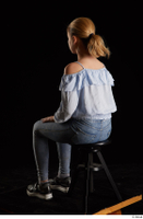 Sarah  1 black sneakers blue blouse blue jeans dressed sitting whole body 0002.jpg