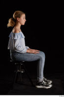 Sarah  1 black sneakers blue blouse blue jeans dressed sitting whole body 0005.jpg