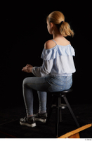 Sarah  1 black sneakers blue blouse blue jeans dressed sitting whole body 0010.jpg