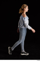 Sarah  1 black sneakers blue blouse blue jeans dressed side view walking whole body 0005.jpg