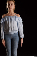 Sarah  1 arm blue blouse dressed flexing front view 0001.jpg