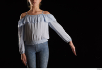 Sarah  1 arm blue blouse dressed flexing front view 0002.jpg