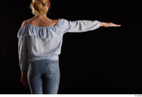 Sarah  1 arm back view blue blouse dressed flexing 0003.jpg