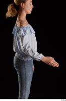 Sarah  1 arm blue blouse dressed flexing side view 0002.jpg