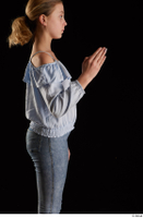 Sarah  1 arm blue blouse dressed flexing side view 0004.jpg