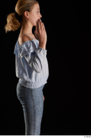 Sarah  1 arm blue blouse dressed flexing side view 0005.jpg