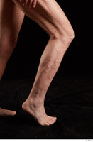 Joseph  1 calf flexing nude side view sitting 0006.jpg