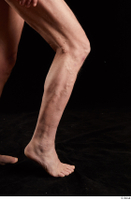 Joseph  1 calf flexing nude side view sitting 0007.jpg