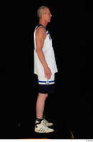 Joseph dressed sports standing white shorts white sneakers white tank top whole body 0007.jpg