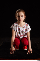 Lilly  1 dressed kneeling red leggings red shoes t shirt trousers whole body 0001.jpg