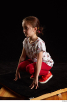 Lilly  1 dressed kneeling red leggings red shoes t shirt trousers whole body 0002.jpg