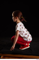 Lilly  1 dressed kneeling red leggings red shoes t shirt trousers whole body 0003.jpg