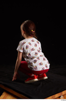 Lilly  1 dressed kneeling red leggings red shoes t shirt trousers whole body 0004.jpg
