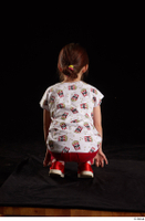 Lilly  1 dressed kneeling red leggings red shoes t shirt trousers whole body 0005.jpg