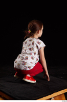 Lilly  1 dressed kneeling red leggings red shoes t shirt trousers whole body 0006.jpg