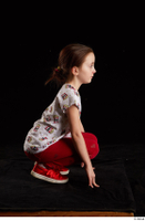 Lilly  1 dressed kneeling red leggings red shoes t shirt trousers whole body 0007.jpg