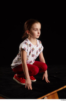 Lilly  1 dressed kneeling red leggings red shoes t shirt trousers whole body 0008.jpg