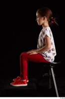 Lilly  1 dressed red leggings red shoes sitting t shirt trousers whole body 0001.jpg
