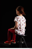 Lilly  1 dressed red leggings red shoes sitting t shirt trousers whole body 0002.jpg