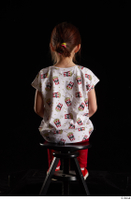 Lilly  1 dressed red leggings red shoes sitting t shirt trousers whole body 0003.jpg