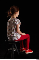 Lilly  1 dressed red leggings red shoes sitting t shirt trousers whole body 0004.jpg
