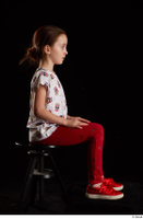 Lilly  1 dressed red leggings red shoes sitting t shirt trousers whole body 0005.jpg