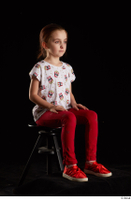 Lilly  1 dressed red leggings red shoes sitting t shirt trousers whole body 0006.jpg