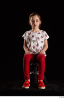 Lilly  1 dressed red leggings red shoes sitting t shirt trousers whole body 0007.jpg